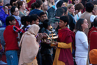 India, Rishikesh.  Foreign visitors and local residents frequent the evening prayer service (aarti) on the banks of the Ganges (Ganga) at the Parmarth Niketan ashram.