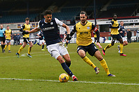 20th February 2021; Dens Park, Dundee, Scotland; Scottish Championship Football, Dundee FC versus Queen of the South; Osman Sow of Dundee takes on Gregor Buchanan of Queen of the South