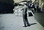 St Louis MO:  A view of a person using a megaphone to get people into the country of Ireland's exhibit.
