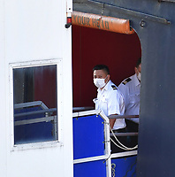 FORT LAUDERDALE, FL - APRIL 02: COVID-19 -Two Coronavirus-Impacted Cruise Ships the MS Zaandam and MS Rotterdam Cleared to Dock in Port Everglades Florida with dead and sick aboard After Weeks at Sea. While the MS Zaandam arrived first and looked like a ghost ship of death. Seen here the healthy people that were transferred to the MS Rotterdam from the MS Zaandam at sea look joyful as finally a country takes them in on April 2, 2020 at Port Everglades in Fort Lauderdale, Florida<br /> <br /> People:  MS Rotterdam