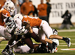Texas A&M Aggies running back Cyrus Gray (32) lunges past Texas Longhorns safety Kenny Vaccaro (16) during the Texas A & M vs. Texas Longhorns football game at the Darrell K Royal - Texas Memorial Stadium in Austin, Tx. Texas A & M defeats Texas 24 to 17....