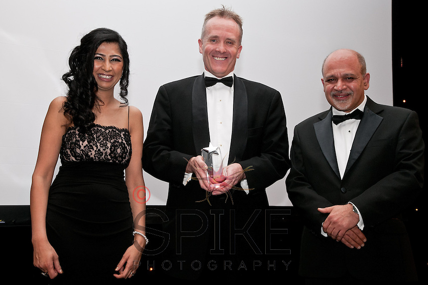 Barrister of the Year - pictured are Hina Desai, director of event sponsors Grant Thornton, winner Shaun Smith QC and President Ash Bhatia