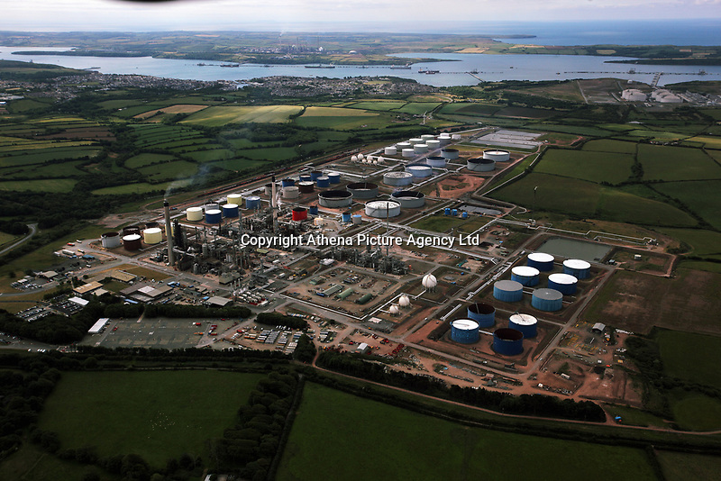Pictured: Aerial view of the Murco Refinery near Milford Haven, Wales, UK<br /> Re: A large dismantled section of an oil refinery has been taken away by road ready to be shipped and rebuilt in Pakistan.<br /> Policing units escorted it on the five-hour journey from the former Murco site in Milford Haven, Pembrokeshire, to Gelliswick Bay on Tuesday.<br /> About 600 people once worked there but it closed in November 2014.<br /> It is now a storage facility, with about 100 people carrying out decommissioning work over two years.<br /> The load will remain on the beach overnight before being taken away by barge on 6 September.<br /> Decommissioning is set to be completed in Autumn 2018, with the whole refinery being re-assembled in Pakistan.