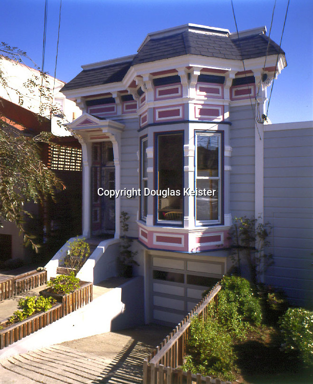 San Francisco, California.  1885.  This nicely proportioned, elegant little Italianate cottage was built as part of a row of 10 cottages, with a very narrow (23 foot) lot.  A pretty, pastel palate picks out the cottage's details nicely.