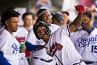 AFL West center fielder Cristian Pache (27), of the Peoria Javelinas and the Atlanta Braves organization, celebrates with teammates Meibrys Viloria (9), Vladimir Guerrero Jr. (27) and Khalil Lee (15) in the dugout after scoring a run during the Fall Stars game at Surprise Stadium on November 3, 2018 in Surprise, Arizona. The AFL West defeated the AFL East 7-6 . (Zachary Lucy/Four Seam Images)