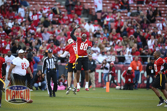 SAN FRANCISCO, CA - JULY 12:  Former San Francisco 49ers greats Steve Young and Jerry Rice celebrate after a first half touchdown during the Legends of Candlestick flag football game at Candlestick Park in San Francisco, California on July 12, 2014. Photo by Brad Mangin