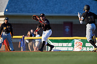Batavia Muckdogs Harrison Dinicola (24) stretches for a throw as Jared Triolo (23) runs up the base line during a NY-Penn League game against the West Virginia Black Bears on June 25, 2019 at Dwyer Stadium in Batavia, New York.  Batavia defeated West Virginia 7-3.  (Mike Janes/Four Seam Images)