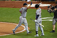 Minnesota Twins Brian Dozier high fives Detroit Tigers Jose Iglesias after hitting a home run during the MLB All-Star Game on July 14, 2015 at Great American Ball Park in Cincinnati, Ohio.  (Mike Janes/Four Seam Images)