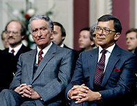 FILE PHOTO - Claude Ryan et Gerard D Levesque lors de l' assermentation du cabinet Bourassa devant le lieutenant-gouverneur Gilles Lamontagne, le 12 decembre 1985<br /> , <br /> PHOTO :   Agence quebec Presse