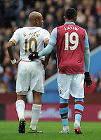 Andre Ayew of Swansea City and brother Jordan Ayew of Aston Villa mark each other at a corner during the Barclays Premier League match between Aston Villa v Swansea City played at the Villa Park Stadium, Birmingham on October 24th 2015