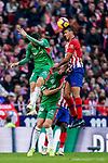 Santiago Arias of Atletico de Madrid heads the ball as he fights for the ball with Deportivo Alaves' players during the La Liga 2018-19 match between Atletico de Madrid and Deportivo Alaves at Wanda Metropolitano on December 08 2018 in Madrid, Spain. Photo by Diego Souto / Power Sport Images