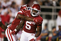 Arkansas running back Raheim Sanders (5) celebrates a score, Saturday, September 11, 2021 during the third quarter of a football game at Reynolds Razorback Stadium in Fayetteville. Check out nwaonline.com/210912Daily/ for today's photo gallery. <br /> (NWA Democrat-Gazette/Charlie Kaijo)