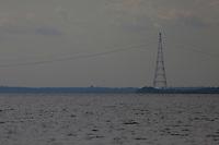 """O Linhão atravessa o Rio Trombetas  ao norte de Oriximiná, Pará.<br /> """"A linha de transmissão de Tucuruí (Linhão de Tucuruí) é uma linha de energia hidrelétrica que leva ao norte da Barragem de Tucuruí no Pará, Brasil, e atravessa o Rio Amazonas, de onde o ramo oriental leva a Macapá, Amapá eo ramal oeste leva a As torres que suportam a travessia do rio Amazonas são quase tão altas quanto a Torre Eiffel.A rede utiliza 3.600 torres de transmissão, com uma extensão média de 500 metros entre torres.A extensão do rio Amazonas é de 2,5 quilômetros (1,6 milhas) .O investimento total foi de US $ 2,29 bilhões. """"<br /> <br />  Plano Nacional de Energia 2030,  e seus projetos de 15 hidrelétricas para Bacia do Trombetas.Oriximiná, Pará, Brasil.<br /> Foto Paulo Santos<br /> 23/09/2016<br /> <br /> The Linhão crosses the Rio Trombetas north of Oriximiná, Pará.<br /> """"The Tucurui transmission line (Linhão Tucuruí) is a hydroelectric power line leading to the north of the Tucuruí dam in Pará, Brazil, and through the Amazon River, where the eastern branch leads to Macapa, Amapá and the west extension leads to the towers that support the crossing of the Amazon river are almost as high as the tower Eiffel.A network uses 3,600 transmission towers, with an average length of 500 meters between torres.A length of the Amazon river is 2.5 kilometers ( 1.6 miles) .The total investment was US $ 2.29 billion. """"<br /> <br />  National Energy Plan 2030 and its 15 hydroelectric projects to Basin Trombetas.Oriximiná, Pará, Brazil.<br /> Photo Paulo Santos<br /> 09/23/2016<br /> <br /> <br /> <br /> https://en.wikipedia.org/wiki/Tucuru%C3%AD_transmission_line"""