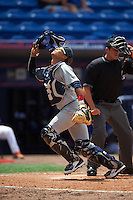 Brevard County Manatees catcher Fidel Pena (18) looks for a foul ball popup in front of umpire Mike Savakinas during a game against the St. Lucie Mets on April 17, 2016 at Tradition Field in Port St. Lucie, Florida.  Brevard County defeated St. Lucie 13-0.  (Mike Janes/Four Seam Images)