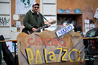 """Giancane (Singer, Musician and songwriter).   <br /> <br /> Rome, 03/12/2020. Today, the Nuovo Cinema Palazzo Community held a second public assembly (1.) in Rome's San Lorenzo district to protest against the eviction of the """"Nuovo Cinema Palazzo"""" completed by the Italian police forces in the early morning of the 25th of November and to demonstrate against the violent reaction of the Police forces when, in the evening of the same day, a large demo asked to have the chance to hold a public assembly in the square (Piazza dei Sanniti) of the cinema (2.). The public assembly of today saw the participation and the support & solidarity of the representatives of movements, actors, musicians, students, artists, politicians, and citizens of San Lorenzo who told their stories and memories related to the famous Rome's Art and culture occupation (For example, actor Marcello Fonte, Best Actor Award of the 2018 Cannes Film Festival for the film Dogman, was among the first group of occupiers of the Nuovo Cinema Palazzo). The assembly of the 1st December was interrupted due to the bad weather (3).<br /> The Nuovo Cinema Palazzo was occupied the 15th of April 2011, when citizens, movements, workers of the entertainment industry reopened the former """"Palazzo Cinema"""" to prevent the opening of a casino/gambling space. The illegal occupation was intended as a public hub of art, culture, sport and politics, an open place for exchange, discussion, studies, caring and sharing.<br /> <br /> Footnotes & Links:<br /> 1. http://bit.do/fLCpE<br /> 2. Demo And Clashes Against Nuovo Cinema Palazzo Eviction in Rome's San Lorenzo: http://bit.do/fLxgz<br /> 3. http://bit.do/fLCr3<br /> Previous Stories about Nuovo Cinema Palazzo: 14.04.2018 - Nuovo Cinema Palazzo's Concert: """"7 Anni di CasiNò 