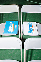 Campaign signs lay on chairs before a campaign rally for Democratic presidential candidate and Vermont senator Bernie Sanders at Hampshire Hills Athletic Club in Milford, New Hampshire, on Tue., Feb. 4, 2020. The  event started around 7pm and was the first event Sanders held after the previous day's Iowa Caucuses. The results of the caucuses were unknown until the Democratic party released partial numbers at 5pm, showing Sanders and former South Bend, Ind., mayor Pete Buttigieg both as frontrunners.