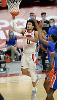 Arkansas forward Justin Smith (0) takes a shot in the lane Tuesday, Feb. 16, 2021, ahead of Florida forward Omar Payne (right) during the first half of play in Bud Walton Arena. Visit nwaonline.com/210217Daily/ for today's photo gallery. <br /> (NWA Democrat-Gazette/Andy Shupe)