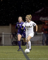 """Boston College forward Kristen Mewis (19) brings the ball out. In overtime, Boston College defeated University of Washington, 1-0, in NCAA tournament """"Elite 8"""" match at Newton Soccer Field, Newton, MA, on November 27, 2010."""