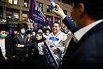 Heshy Tischler, right of center, leader of the anti-lockdown protest, holds a sign for President Trump at a protest against COVID-19 restrictions in the Orthodox Jewish neighborhood Borough Park on Wednesday, October 7, 2020 in the Park in the Brooklyn borough of New York City.  Residents are protesting against new restrictions that would close schools, limit attendance at religious services and close non-essential businesses in areas with surges in COVID-19 cases.  Photograph by Michael Nagle