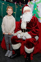 Pictured: Father Christmas Monday 11 December 2017<br /> Re: Swansea City FC children Christmas part at the Liberty Stadium, Swansea, Wales, UK