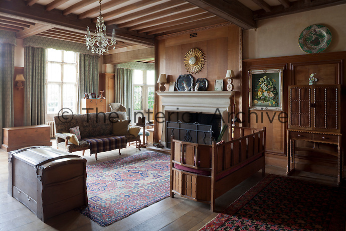 A living area, with panelling designed by Alfred Powell and furniture by Alfred Wright's joiners