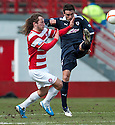 Accies Stevie May and Raith's Laurie Ellis challenge for the ball.