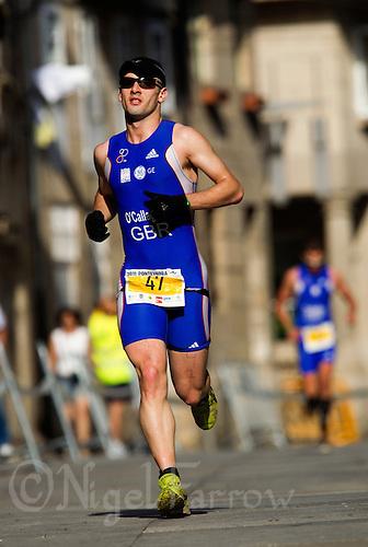26 JUN 2011 - PONTEVEDRA, ESP - Tyler O'Callaghan (GBR) - European Age Group Olympic Distance Triathlon Championships .(PHOTO (C) NIGEL FARROW)