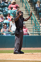 Home plate umpire James Jean calls time during the South Atlantic League game between the Charleston RiverDogs and the Hickory Crawdads at L.P. Frans Stadium on May 13, 2019 in Hickory, North Carolina. The Crawdads defeated the RiverDogs 7-5. (Brian Westerholt/Four Seam Images)