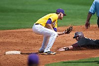 LSU Tigers second baseman JaCoby Jones #23 tags out a base stealer during the NCAA baseball game against the Mississippi State Bulldogs on March 18, 2012 at Alex Box Stadium in Baton Rouge, Louisiana. LSU defeated Mississippi State 4-2. (Andrew Woolley / Four Seam Images).