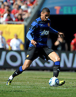 Manchester United defender Chris Smalling (12) crosses the ball.  Manchester United defeated the Chicago Fire 3-1 at Soldier Field in Chicago, IL on July 23, 2011.