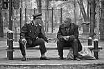 Two Friends Chat In A Park On The Songhua River, Ha'erbin, China.