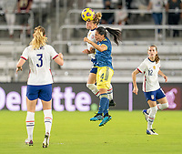 ORLANDO, FL - JANUARY 22: Emily Sonnett #14 of the USWNT heads the ball against Diana Ospina #4 of Colombia during a game between Colombia and USWNT at Exploria stadium on January 22, 2021 in Orlando, Florida.