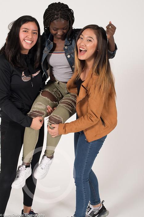 High School seniors informal portraits three female friends