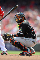 Miami Marlins catcher Miguel Olivo #21 during a game against the Cincinnati Reds at Great American Ball Park on April 20, 2013 in Cincinnati, Ohio.  Cincinnati defeated Miami 3-2 in 13 innings.  (Mike Janes/Four Seam Images)