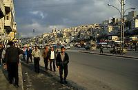 Pedestrians walking along the streets of Amman, Jordan.