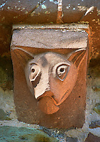 Norman Romanesque exterior corbel no 21 - sculpture of an animal with a long snout and pointed ears. The Norman Romanesque Church of St Mary and St David, Kilpeck Herefordshire, England. Built around 1140
