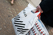 Oxford Street shoppers with a John Lewis store bag