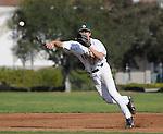 Baseball infielder makes a throw on the run.
