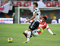 BOGOTA - COLOMBIA -22 -03-2014: Rafael Perez (Der.) jugador de Independiente Santa Fe disputa el balón con Yeison Gordillo (Izq.) jugador de Boyaca Chico FC, durante partido por la fecha 12 de la Liga Postobon I-2014, jugado en el estadio Nemesio Camacho El Campin de la ciudad de Bogota. / Rafael Perez (R) player of Independiente Santa Fe vies for the ball with Yeison Gordillo (L) player of Boyaca Chico FC during a match for the 12th date of the Liga Postobon I-2014 at the Nemesio Camacho El Campin Stadium in Bogota city, Photo: VizzorImage  / Luis Ramirez / Staff.