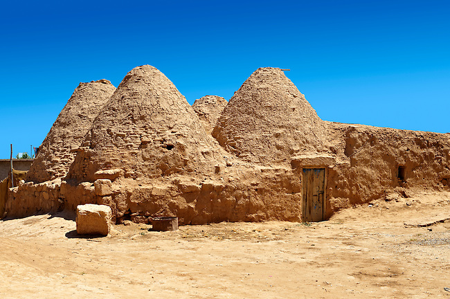 """Pictures of the beehive adobe buildings of Harran, south west Anatolia, Turkey.  Harran was a major ancient city in Upper Mesopotamia whose site is near the modern village of Altınbaşak, Turkey, 24 miles (44 kilometers) southeast of Şanlıurfa. The location is in a district of Şanlıurfa Province that is also named """"Harran"""". Harran is famous for its traditional 'beehive' adobe houses, constructed entirely without wood. The design of these makes them cool inside. 43"""