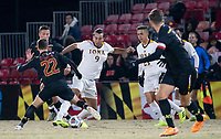 COLLEGE PARK, MD - NOVEMBER 21: Esad Mackic #9 of Iona dribbles around Nick Richardson #22 of Maryland during a game between Iona College and University of Maryland at Ludwig Field on November 21, 2019 in College Park, Maryland.