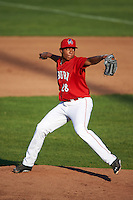 Auburn Doubledays relief pitcher Francys Peguero (28) delivers a pitch during a game against the Mahoning Valley Scrappers on June 19, 2016 at Falcon Park in Auburn, New York.  Mahoning Valley defeated Auburn 14-3.  (Mike Janes/Four Seam Images)