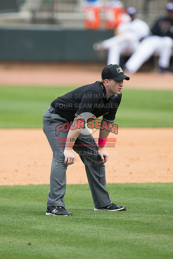 Umpire Chase Eade handles the calls on the bases during the Carolina League game between the Myrtle Beach Pelicans and the Winston-Salem Dash at BB&T Ballpark on May 10, 2015 in Winston-Salem, North Carolina.  The Pelicans defeated the Dash 4-3.  (Brian Westerholt/Four Seam Images)