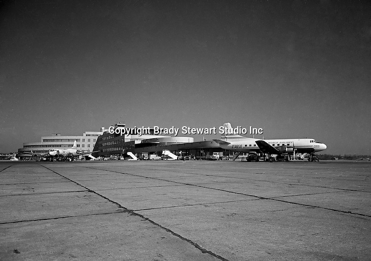 Pittsburgh PA:  TWA DC-3 Skyliner airplanes loading passengers at the Greater Pittsburgh Airport.