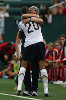 USWNT's Abby Wambach (20) embraces her coach, Pia Sundhage after scoring her 100th career goal in the second half. The U.S. Women's National Team defeated Canada 1-0 in a friendly match at Marina Auto Stadium in Rochester, NY on July 19, 2009.