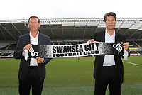 Michael Laudrup is official unveiled as the new manager of Swansea City FC in a press conference at the Liberty Stadium, today, 21/06/12<br /> Pictured: Michael Laudrup poses with a swansea city scarf<br /> Picture by: Ben Wyeth / Athena Picture Agency