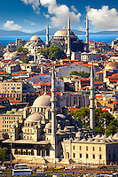 The Yeni Camii, The New Mosque or Mosque of the Valide Sultan (foreground) ordered by Safiye Sultan in 1597 on  the banks of the Golden Horn, Istanbul Turkey.