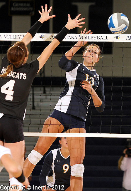 SIOUX FALLS, SD - SEPTEMBER 18:  Taylor Hrdlichka #13 from Augustana tips the ball past Cori Hobbs #4 from Wayne State in the first match of their game Tuesday night at Augustana. (Photo by Dave Eggen/Inertia)