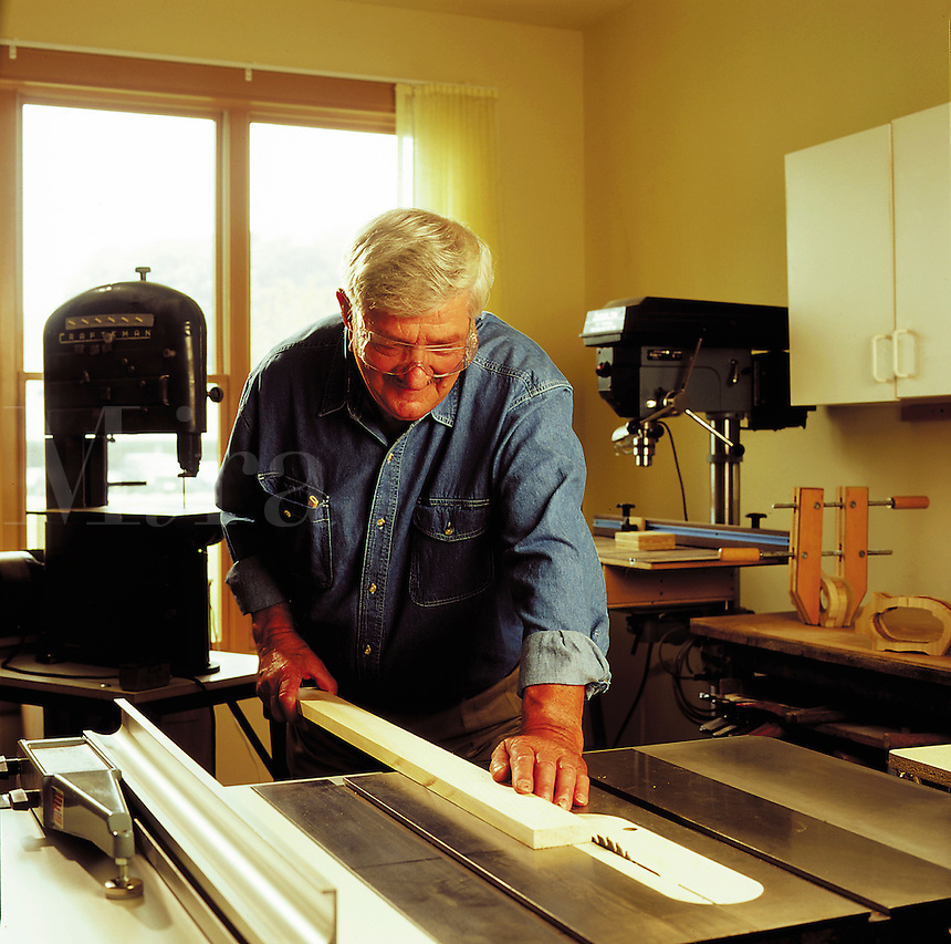 Older man woodworking.