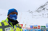 16th October 2020, Rettenbachferner, Soelden, Austria; FIS World Cup Alpine Skiing course set up; Alpine Ski World Cup 2020-2021 - during the Coronavirus Outbreak . One day before the Giant Slalom as part of the Alpine Ski World Cup in Solden ; A man wearing a protective mask in front of the ski course